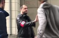 Moment a Nazi wearing a swastika armband is tracked down and beaten in Seattle after 'harassing a black man on a bus'.