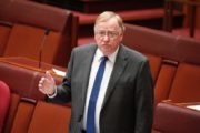 LNP senator Ian Macdonald says racism in Australia is isolated, questions role of discrimination commissioner