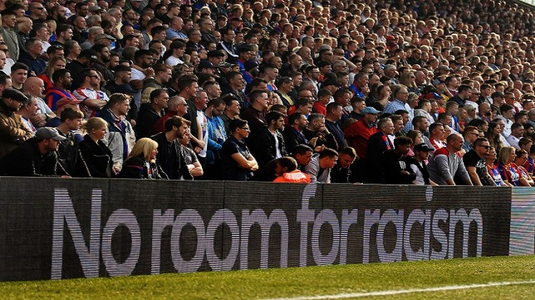 How can players and clubs stand up to racism in football when they are punished for it