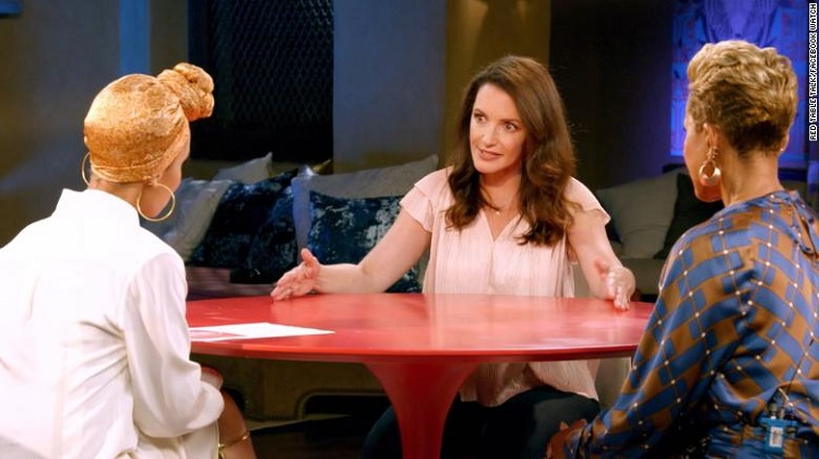 Kristin Davis tears up recalling racism directed at her baby
